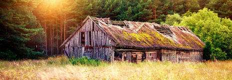 Scenic old barn. Old barn or shed in field at sunset royalty free stock image