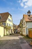 Scenic old road with cobble stone and half timbered houses in Marktheidenfeld, Germany. Scenic old road with cobble stone and half timbered houses in royalty free stock photos