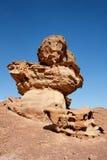 Scenic orange rock in shape of mushroom in desert Royalty Free Stock Photo