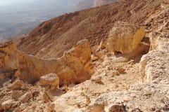 Scenic orange rocks in desert canyon. (Small Crater, or Makhtesh Katan in Negev desert, Israel&#x29 Royalty Free Stock Photos