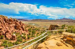 Scenic Overlook - Arches National Park - Moab, Utah. Wood log fence marks boundary of scenic overlook above fiery furnace rock formation at Arches National Park Stock Photos
