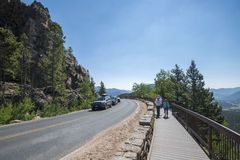 Scenic overlook at the Rocky Mountains. Pedestrians walk on one of the roadside scenic overlooks at the Rocky Mountain National Park in Colorado Royalty Free Stock Photos