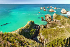 Scenic Pacific Ocean Coast, New Zealand. Scenic Nugget Point Cape, Southern Pacific Ocean, Catlins Coast. New Zealand Royalty Free Stock Photo