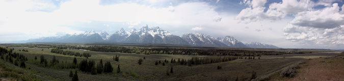 Scenic panarama of the grand tetons. Panarama from a stop along the grand tetons in wyoming. A scenic panarama with a meadow and mountains Stock Photo