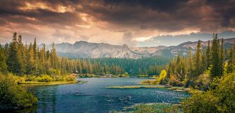 Scenic Panorama of Lake by Mountains Royalty Free Stock Photos