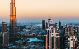Scenic panorama view of Dubai`s business bay towers at sunset. Architectural background. Stock Photos