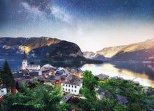 Scenic panoramic view of the famous mountain village in the Austrian Alps. Fantastic milky way. Hallstatt. Austria Stock Photo