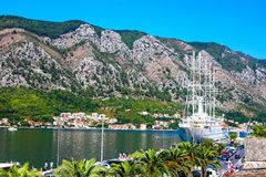 Scenic panoramic view of the historical city of Kotor on the shore of which there is an airliner located in the Bay of Kotor among stock photography