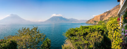 Scenic panoramic view of lake Atitlan and Volcanoes San Pedro and Toliman in Guatemala Stock Image