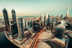 Scenic panoramic view of modern city at sunset. Aerial skyline of Dubai, UAE Royalty Free Stock Photography