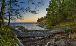 Scenic panoramic view of the ocean and Jack Point and Biggs Park. Scenic sunset panoramic view of the ocean overlooking at the Strait of Georgia from Jack Point royalty free stock images