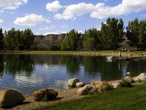 Scenic Park. Beautiful Park located in Medicine Hat, Alberta. Kid splashing into the water in the background stock image