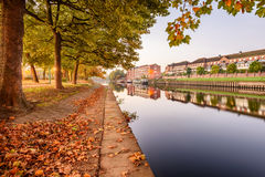 Scenic Path River Ouse UK. Attractive riverside of York on river Ouse on beautiful calm day with colorful leaves and reflections Royalty Free Stock Photos
