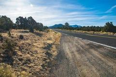 County road in Arizona, USA. Scenic picture of county road in the desert and the blue sky in Arizona USA stock image