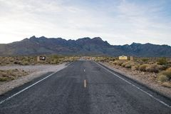 County road in Arizona, USA. Scenic picture of county road in the desert and the blue sky in Arizona USA royalty free stock image
