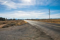 County road in Arizona, USA. Scenic picture of county road in the desert and the blue sky in Arizona USA royalty free stock photo