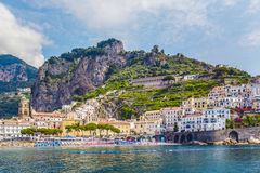 The small haven of Amalfi village with the tiny beach and colorful houses, located on the rock, Amalfi coast, Sorrento, Italy. Scenic picture-postcard view of Stock Photos