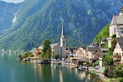 Scenic picture-postcard view of famous Hallstatt mountain village in the Austrian Alps. Beautiful light in summer, Salzkammergut r royalty free stock image