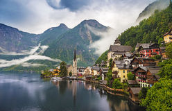 Scenic picture-postcard view of famous Hallstatt mountain village with Hallstaetter Lake in the Austrian Alps, region of Salzkamme Royalty Free Stock Photo