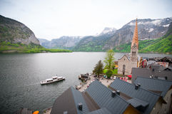 Scenic picture-postcard view of famous Hallstatt mountain village with Hallstaetter See in the Austrian Alps, region of. Hallstatt /ˈhalʃtat/; Central stock image