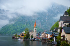 Scenic picture-postcard view of famous Hallstatt mountain village with Hallstaetter See in the Austrian Alps, region of Salzkammer Stock Photos