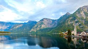Scenic picture-postcard view of famous Hallstatt mountain village with Hallstatter lake in Austrian Alps. royalty free stock image