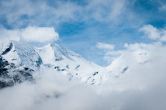 Scenic picture-postcard view of famous place, Grossglockner mountain with cloud & fog, Austria royalty free stock photo