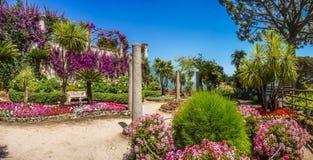 Scenic picture-postcard view of famous Villa Rufolo gardens in Ravello at Amalfi Coast with Gulf of Salerno, Campania, Italy Stock Photo