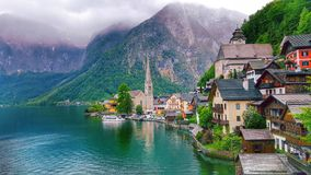 Scenic picture-postcard view of little famous Hallstatt mountain village with Hallstaetter Lake in the Austrian Alps, region of Sa Stock Photos