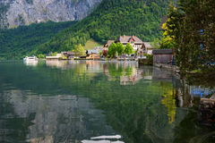 Scenic picture-postcard view of traditional old wooden houses in famous Hallstatt mountain village at Hallstattersee lake Stock Photos