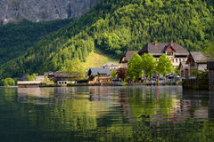 Scenic picture-postcard view of traditional old wooden houses in famous Hallstatt mountain village at Hallstattersee lake Royalty Free Stock Photography