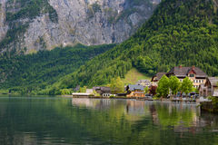 Scenic picture-postcard view of traditional old wooden houses in famous Hallstatt mountain village at Hallstattersee lake Royalty Free Stock Photos