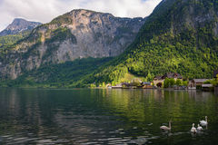 Scenic picture-postcard view of traditional old wooden houses in famous Hallstatt mountain village at Hallstattersee lake Stock Photo