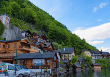 Scenic picture-postcard view of traditional old wooden houses in famous Hallstatt mountain village at Hallstattersee lake Royalty Free Stock Images