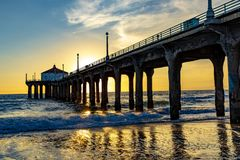 Scenic pier at Manhattan Beach near Los Angeles in sunset stock photo