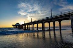Scenic pier at Manhattan Beach near Los Angeles in sunset stock image