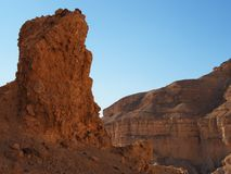 Scenic pillar rock in a stone desert at sunset Royalty Free Stock Photography