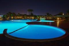 Scenic pool night lights, night sky Royalty Free Stock Photos