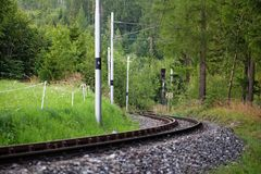 Scenic railway between the trees. Scenic railway in the summer forest near Vysne Hagy in High Tatra Mountains, Slovakia, Europe stock images