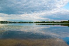Reflecting lake in rural Lithuania stock photos