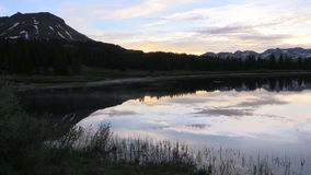 Scenic Reflection in Sunrise. A scenic reflection of the Colorado mountains in summer stock footage