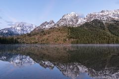 Autumn Reflection of the Tetons at Sunrise. A scenic reflection of the Tetons at sunrise in autumn in string lake Royalty Free Stock Images