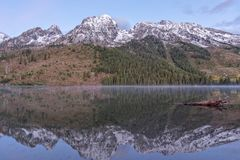 Scenic Autumn Reflection of the Tetons at Sunrise. A scenic reflection of the Tetons at sunrise in autumn in string lake Royalty Free Stock Image