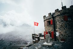 Scenic refuge house with swiss flag royalty free stock photo