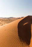 Scenic ridges of sand dunes in Sossusvlei, Namib Naukluft National Park, best tourist and travel attraction in Namibia. Adventure Stock Photo