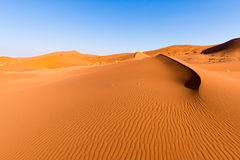 Scenic ridges of sand dunes in Sossusvlei, Namib Naukluft National Park, best tourist and travel attraction in Namibia. Adventure. And exploration in Africa Stock Images