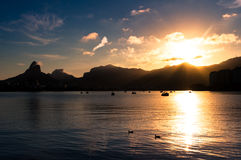 Scenic Rio de Janeiro Sunset. Scenic sunset in Rio de Janeiro with lake and mountains in the horizon Stock Image
