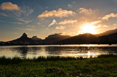Scenic Rio de Janeiro Sunset. Scenic sunset in Rio de Janeiro with lake and mountains in the horizon Royalty Free Stock Photos