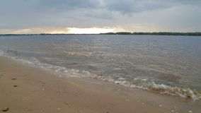 Scenic river landscape in the evening at sunset. Sandy beach. The Volga river, Samara city, Russia stock video footage