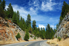 Scenic road against blue sky to Yosemite Stock Photos